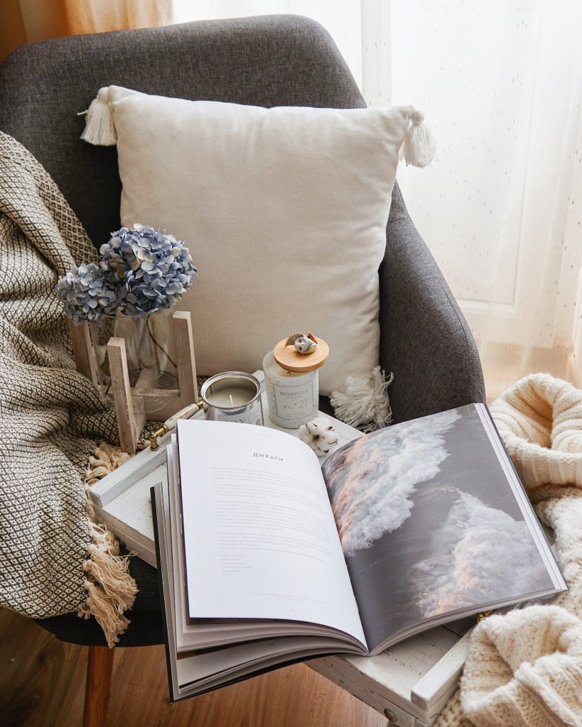 book, candle, and flower