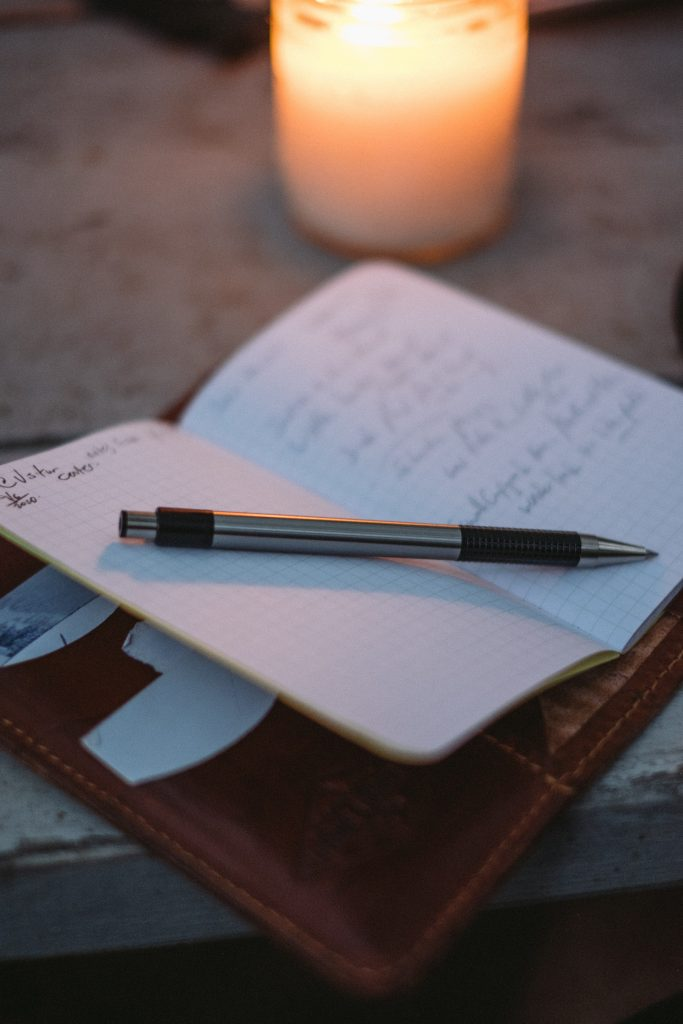candle notebook pen